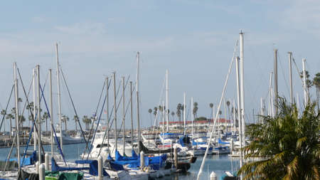 Oceanside, California USA - 27 Jan 2020: Waterfront harbor fisherman village, luxury yachts sailboats floating, marina harbour quay. Sail boat masts, nautical vessels anchored or moored in port. Standard-Bild - 161603737