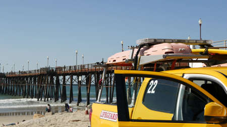 Oceanside, California USA - 8 Feb 2020: Yellow lifeguard car, beach near Los Angeles. Coastline rescue, life guard Toyota pick up truck, lifesavers vehicle. Iconic auto on ocean coast. Public safety. Standard-Bild - 161603753