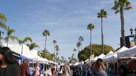 Oceanside, California USA -20 Feb 2020 People walking on marketplace, customers on farmers market. Buyers support business, vendors sell locally produced goods. Outdoor street trading stalls and tents Standard-Bild - 161603812