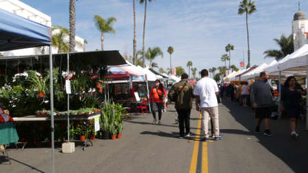 Oceanside, California USA -20 Feb 2020 People walking on marketplace, customers on farmers market. Buyers support business, vendors sell locally produced goods. Outdoor street trading stalls and tents Standard-Bild - 161603811