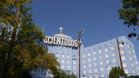 Los Angeles, California USA - 24 Feb 2020: Church of Scientology exterior, facade of blue building near American Saint Hill Organization in Hollywood. Logo and cross. International religious movement. Editorial