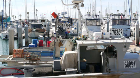 Oceanside, California USA - 26 Feb 2020: Harbor village with fisherman boats and yachts, pacific ocean coast marina, sea shore. Nautical vessel for fishing in port, fishery industry. Quay in bay. Editorial