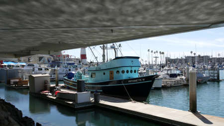 Oceanside, California USA - 26 Feb 2020: Harbor village with fisherman boats and yachts, pacific ocean coast marina, sea shore. Blue nautical vessel for fishing in port, fishery industry. Quay in bay. Standard-Bild - 161603798