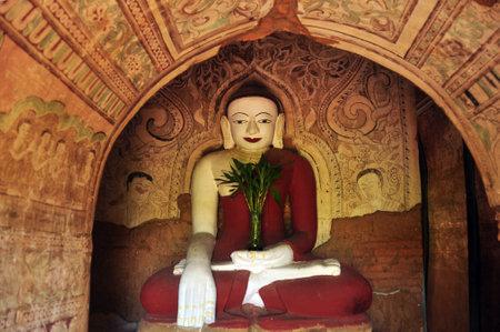 BAGAN, MYANMAR - NOVEMBER 18, 2015: Huge colored statue of Buddha in temple, From below shot of colorful Buddha statue in ornamental temple. Mingalazedi Sulamani Shwezigon Ananda Htilominlo Editorial