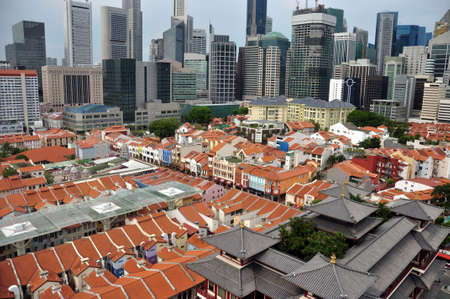 Chinatown in modern megapolis, View of orange rooftops of Chinatown with highrise buildings of modern futuristic city, Singapore Editorial