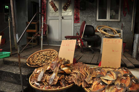 Local market stall with assortment of exotic dried food for sale. Exotic dried seafood for sale on street market