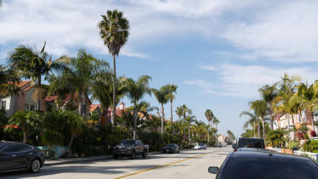 California typical suburban street, tropical Oceanside USA. Different colorful houses row. Generic american homes, buildings facade, townhouse exterior architecture. Residential district real estate.