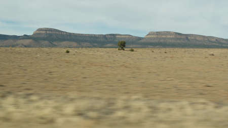 Road trip from Grand Canyon, Arizona USA. Driving auto, route to Las Vegas, Nevada. Hitchhiking traveling in America, local journey, wild west calm atmosphere, indian lands. Wilderness thru car window