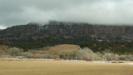 Road trip in USA from Zion to Bryce Canyon, driving auto in Utah. Hitchhiking traveling in America, Route 89 to Dixie Forest. Winter local journey, calm atmosphere and snow mountains. View from car. Standard-Bild