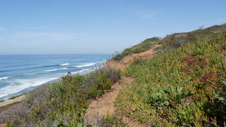 Seascape vista point, viewpoint in Del Mar near Torrey Pines, California coast USA. Frome above panoramic ocean tide, blue sea waves, steep eroded cliff. Coastline overlook, shoreline high angle view