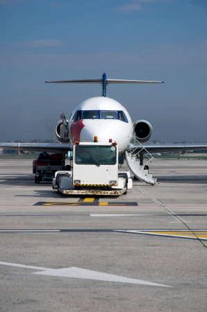 pista: Plane landing on the track