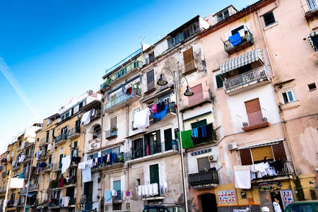 Castellammare di Stabia, Naples Italy - February 17: Scene of daily life in a popular district of a town of Naples with clothes to dry in the sun on the balconies on Naples 17 February 2014