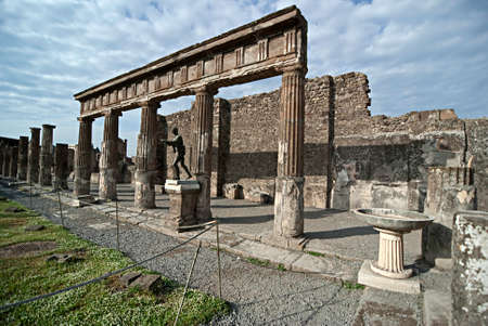 Apollo Temple in Pompeii Pompeii is a ruined and partially buried Roman town-city near modern Naples in the Italian region of Campania, in the territory of the comune of Pompei.