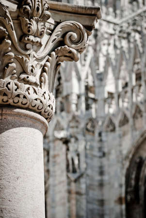 Architecture in Piazza Duomo in Milan. Milan Cathedral (Italian: Duomo di Milano) is the cathedral church of Milan in Lombardy, northern Italy. photo