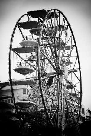 amusement park black and white: A colourful ferris wheel Stock Photo