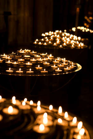 votive candle: A votive candle, originally intended to be burnt as a votive offering in a religious ceremony.