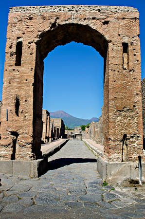 Pompeii is a ruined and partially buried Roman towncity near modern Naples in the Italian region of Campania in the territory of the town of Pompeii. Along with its sister city Herculaneum Pompeii was destroyed and completely buried during a long catastro