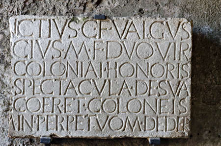social history: marble plaque at the entrance of Roman amphitheater in Pompeii where the Gladiators fought
