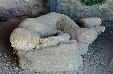 mummified: Some plaster casts of victim of the eruption still in actual PompeiiThe city is mainly famous for the ruins of the ancient city of Pompeii located in the frazione of Pompei Scavi. Stock Photo