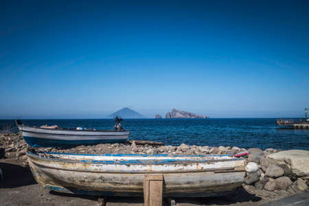 aeolian: Boat of fisherman in the Aeolian Islands. In the background you can see the volcano Stromboli