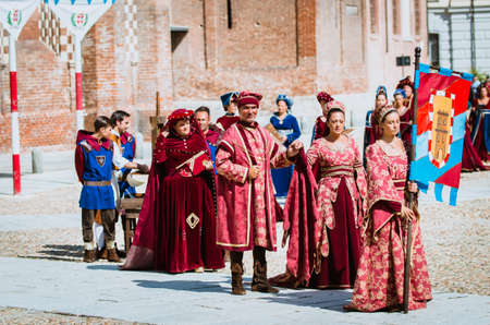 middle ages: Asti, Italy - September 16, 2012: Procession of street performers in medieval costumes parading in the Palio of Asti. A group of noble fashion in the Middle Ages Editorial