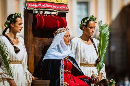 palio: Asti, Italy - September 16, 2012: Procession of street performers in medieval costumes parading in the Palio of Asti