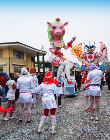 viareggio: Viareggio, Italy - February 24, 2010: Parade float whith Pig nurse During The Carnival of Viareggio on the Tuscany Italy. Editorial