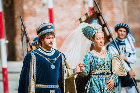 palio: Asti, Italy - September 16, 2012: pair of noblemen in medieval costumes in historical parade on the day of the Palio in Asti, Italy