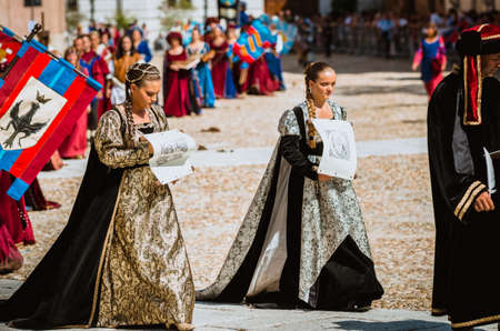 palio: Asti, Italy - September 16, 2012: Procession of street performers in medieval costumes parading in the Palio of Asti. A pair of noble fashion in the Middle Ages