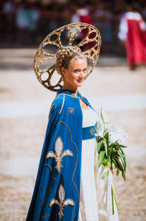historical period: Asti, Italy - September 16, 2012: Young Medieval Princess, during the historic parade of the Palio of Asti in Piedmont, Italy Editorial