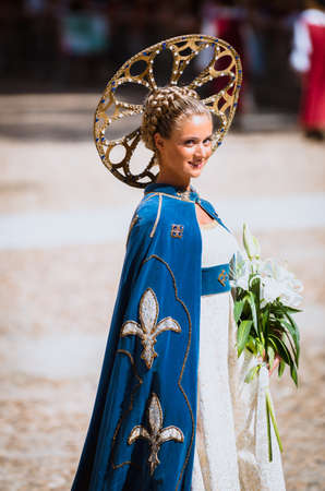 palio: Asti, Italy - September 16, 2012: Young Medieval Princess, during the historic parade of the Palio of Asti in Piedmont, Italy Editorial