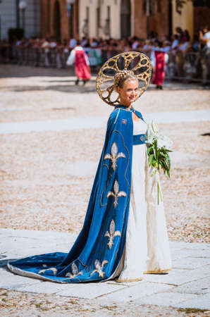 procession: Asti, Italy - September 16, 2012: Young Medieval Princess, during the historic parade of the Palio of Asti in Piedmont, Italy Editorial