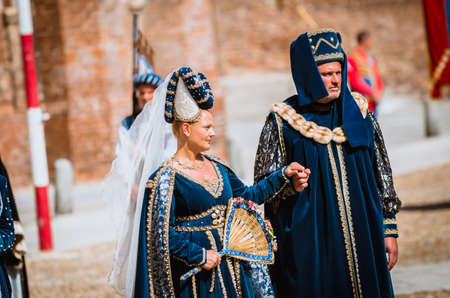 palio: Asti, Italy - September 16, 2012: Couple of senior nobles in medieval costumes in historical parade on the day of the Palio in Asti, Italy