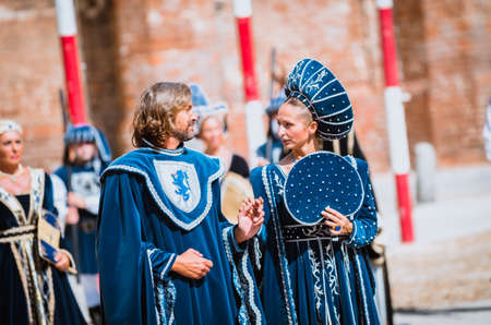 palio: Asti, Italy - September 16, 2012: couple of young noblemen in medieval costumes in historical parade on the day of the Palio in Asti, Italy