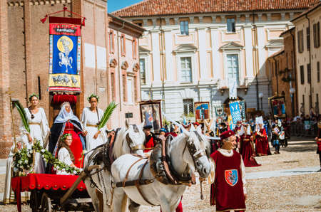 palio: Asti, Italy - September 16, 2012: Procession of street performers in medieval costumes parading in the Palio of Asti.Parade of medieval princess sitting on the throne.