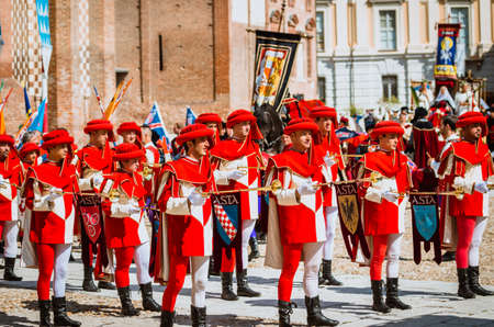 palio: Asti, Italy - September 16, 2012: the historical Medieval parade of the Palio of Asti in Piedmont, Italy. Drummer and trumpeters in medieval parade and flag-wavers of the districts