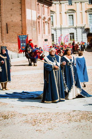 nobles: Asti, Italy - September 16, 2012: Couple of senior nobles in medieval costumes in historical parade on the day of the Palio in Asti, Italy