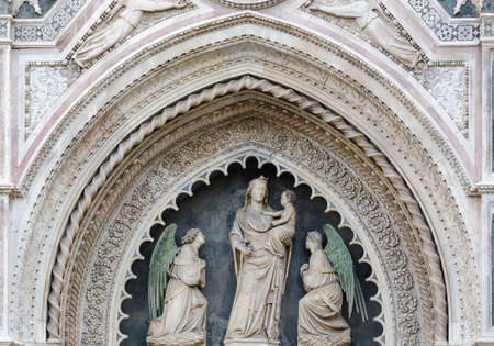 fiore: Madonna and Child sculptures on the facade of Santa Maria in Fiore in Florence, Italy