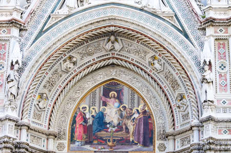 enthroned: Christ enthroned with Mary and St. John the Baptist painted on the facade of Santa Maria in Fiore in Florence, Italy