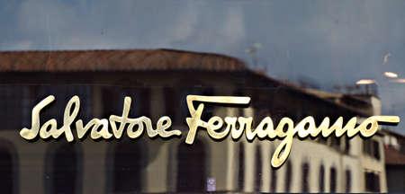 italian architecture: Florence, Italy - June 28, 2014: Salvatore ferragamo store sign in the heart of the city of Florence, Italy. Sign with reflections of the typical Italian architecture