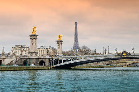 alexandre: Eiffel Tower and Pont Alexandre III over the Seine in Paris, France Stock Photo