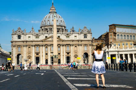 st  peter's square: Rome, Italy - June 30, 2016:  tourist is taking a photo of the basilica of St. Peters square in Rome, Italy