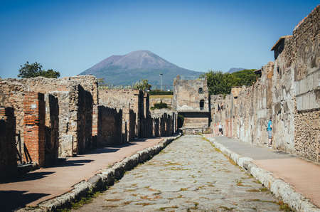 old mercury: Tower of Mercury with Volcano Mount Vesuvius in the background, Pompeii.  Pompeii was destroyed by the eruption of the volcano Vesuvius in AD 79.