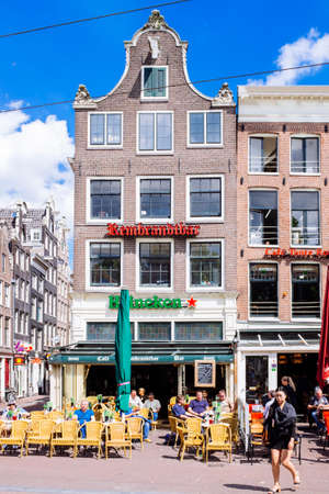 June 2016: Amsterdam, Netherlands.  tourists on a beautiful June day in Rembrandtplein in Amsterdam