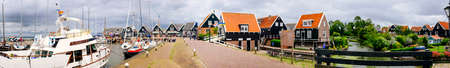 Volendam, Netherlands - June 30, 2016: Panorama of the port of Volendam on a cloudy spring day, Volendam is a village north of Amsterdam pencatori