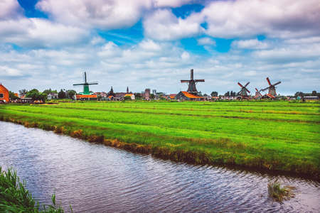 holland windmill: Vintage style of traditional Dutch Windmills and cottages in Zaanse Schans.