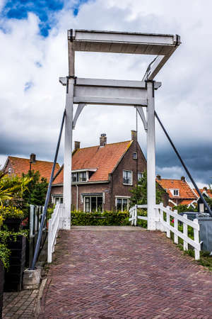 Netherlands, the small movable bridge and canal in the village of Volendam