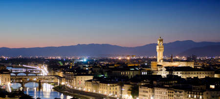 Aerial panorama of Florence city, Arno River and Ponte Vecchio at sunset. Stock Photo