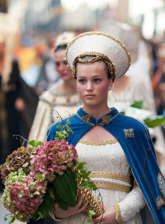 Young damadel Middle Ages at the Palio with flowers Editorial