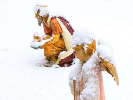 Christmas nativity scene, angel with lamb in the snow
